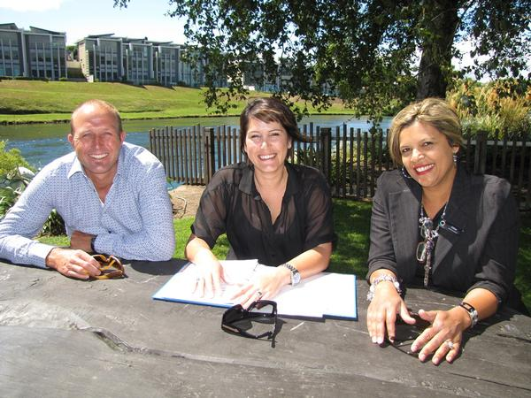 District Events Manager, Nick Reader, Taupō Summer Concert Promoter Amanda Calvert and Taupō Events Coordinator Gillian Taplin go over plans for the upcoming concert in Taupō's Riverside Park.