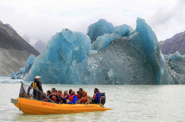 In perspective &#8211&#x3b; a Glacier Explorers boat near the calving site.