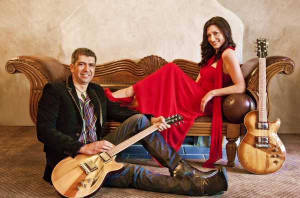 Christchurch singer Mandy Pickering and guitarist husband, Jason with the unique guitars.