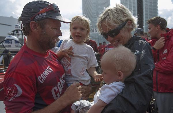 CAMPER skipper Chris Nicholson is reuntied with his family.
