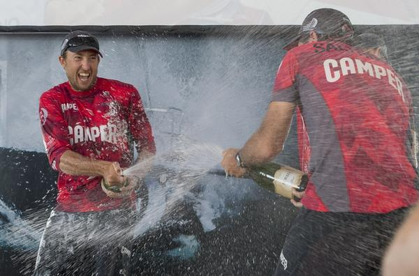 The CAMPER crew enjoy their champagne moment.
