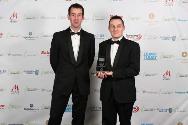 Matt Diack and Paul Cook receiving their NZ Travel Industry award at the Langham Hotel in Auckland last Saturday.