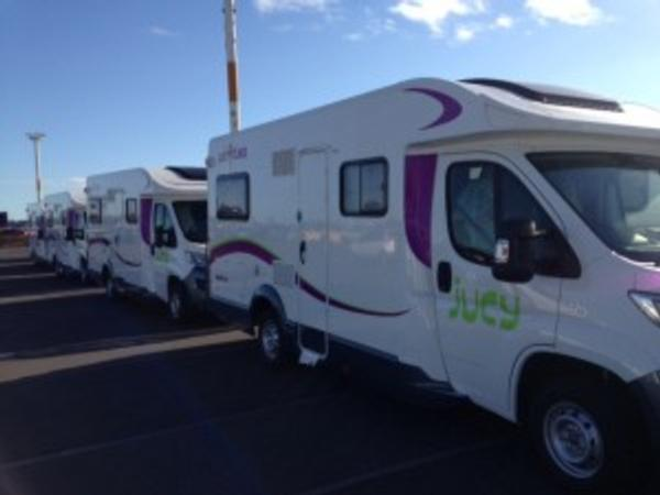 Jucy rentals happy with the safe arrival of 50 motorhomes in NZ courtesy of McCullough Shipping.