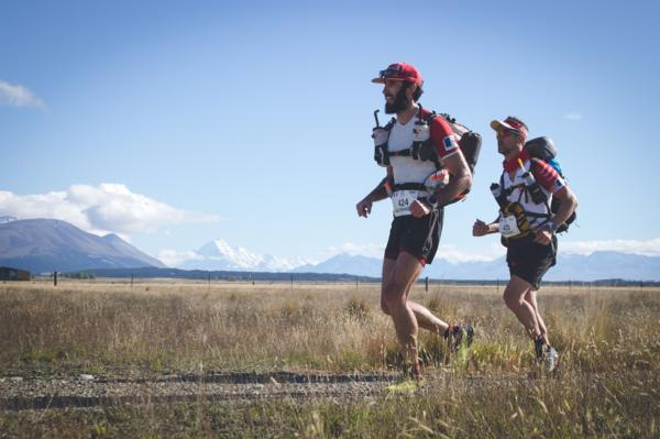 Winners of Team Race last year, Alexandre Lucas and Vincent Hulin of France running through the Mackenzie district with Mt Cook in the background