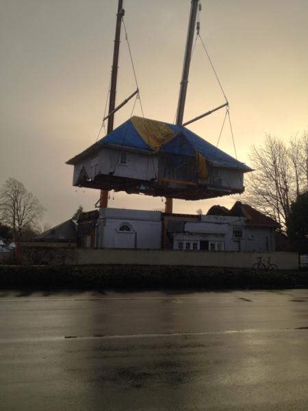 House being lifted into position after being moved following EQs