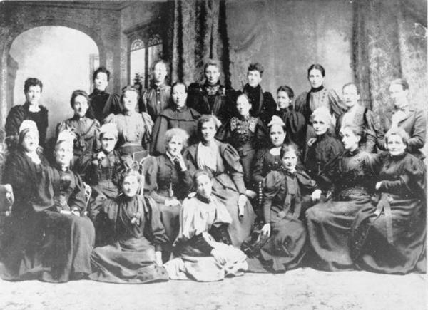 First meeting of the National Council of Women in ChCh in 1896. Kate Sheppard is 5th from the left, seated.