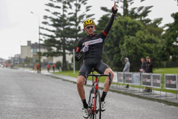 Sam Horgan soloed to an impressive elite win in round three of the Calder Stewart Cycling Series, the CYB Construction Hokitika Classic, on the South Island's West Coast, to also claim the elite series lead.