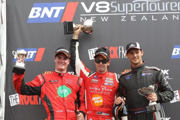 Greg Murphy on the podium for his round one win at Hampton Downs.
