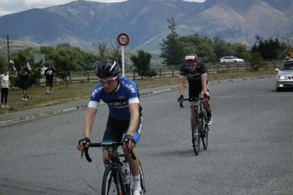 A satisfied Tim Rush rolls across the line ahead of Kees Duyvestyn to win the inaugural That Dam 108 kilometre Powerhouse road race