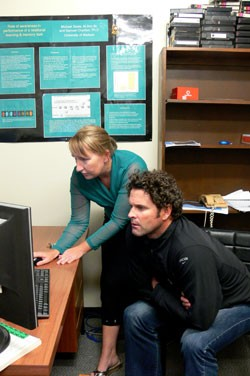 Off the Rails: Masters student Helen Clark gives cricketer and rail safety campaigner Chris Cairns a demonstration of her computer simulated experiment during his visit to discuss her research.