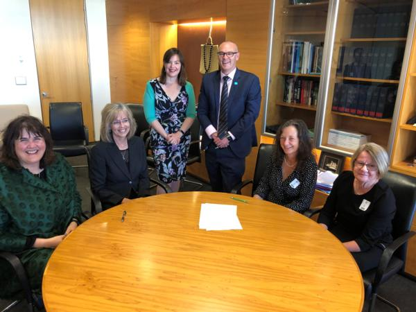 L to R Keriana Brooking (Dep Dir-Gen on behalf of MoH), Helen Mason (CE BoP signing on behalf of DHBs),  Hon Julie Anne Genter (Assoc Min of Health),  Hon David Clark (Min of Health),  Caroline Conroy (MERAS Co-leader: Midwifery) and Hilary Graham-Smith (Associate Professional Services Manager NZNO)
