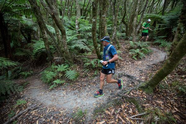 Runners in natural New Zealand forest in the 2013 Vibram Tarawera Ultramarathon