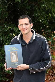 Massey technician Kerry Griffiths with his historical  book based around 19th century Picton politician  Arthur Seymour.