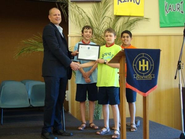 iWay Team Leader Owen Mata presents the challenge certificates to Oliver Chamberlain, Josiah Barlow and Tanmay Rege from Hastings Intermediate.