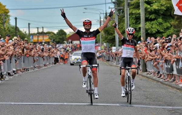 Hayden Roulston celebrates victory from George Bennett in the Calder Stewart national road cycling championships in January.