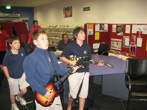 Youth �having a go� at the Guitar Hero III practise sessions at Taupo Library