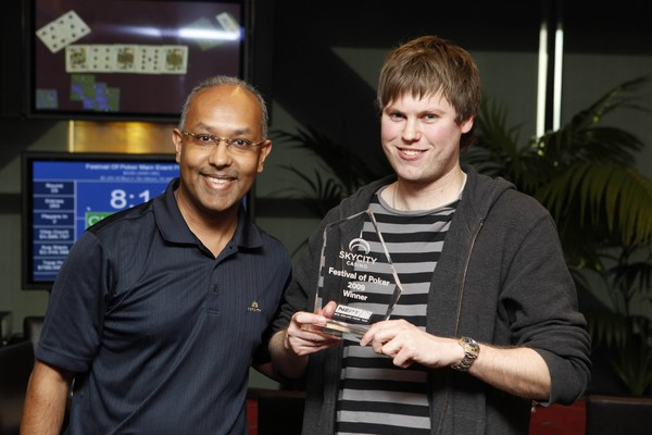 KYCITY Festival of Poker winner Simon Watt; Simon in action earlier in the day and Simon with Executive Manager of Table Games, Ejaaz Dean and his trophy.