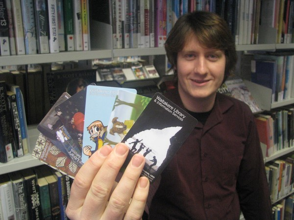 Daniel Mayo-Turner shows off some of the new library cards on offer