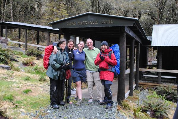 Margaret Mackenzie-Hooson (L) with her fellow travellers and guide at Lake Mackenzie Lodge on the Routeburn Track.