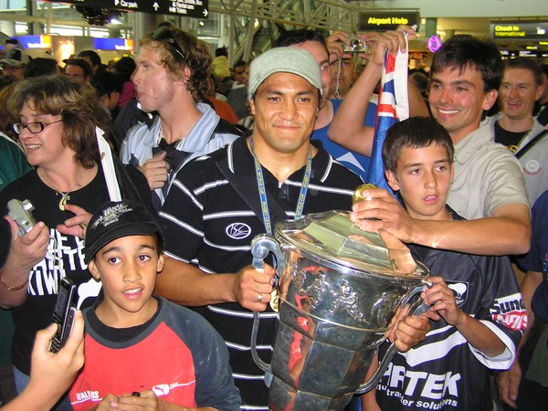 Jerome Ropati with fans and the cup