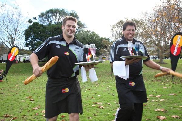 Don't give up your day job: All Black Richie McCaw and Rugby Legend, Buck Shelford, practice Waiter Racing ahead of the All Blacks MasterCard Roadshow