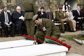 Corporal Willie Apiata VC lays a wreath at the gravesite of Lord Bernard Freyberg