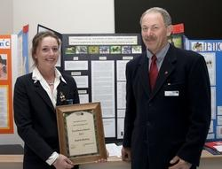 Sophie Burling with the 'Excellence Award' she received from Northland Regional Council member Joe Carr.
