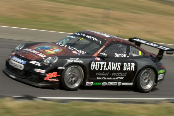 Earl Bamber secured his first podium finish in a saloon car race today by finishing third driving the Outlaws Bar Porsche 997 for the Triple X Motorsport team at Ruapuna near Christchurch today