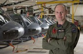 Wing Commander Ian MacPherson at home in the 3 Squadron hangar.